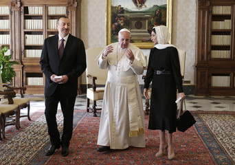 Pope Francis talks with President of Azerbaijan Aliyev and his wife Aliyeva during a meeting at the Vatican