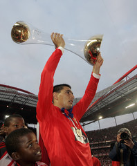 Benfica's Cardozo holds up the Portuguese Premier League trophy after beating Rio Ave at Luz stadium in Lisbon