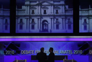 Chilean presidential candidates chat before starting a live televised debate in Santiago