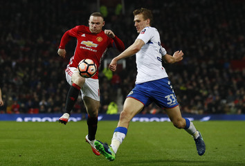 Manchester United's Wayne Rooney in action with Wigan Athletic's Dan Burn