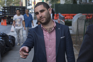 Bitcoin promoter Shrem points to a obstacle behind a photographer as he walks out of federal court in Lower Manhattan, New York
