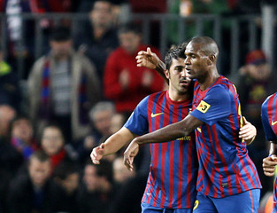 Barcelona's Abidal celebrates teammate Villa's goal against Rayo Vallecano during their Spanish first division soccer match at Nou Camp stadium in Barcelona