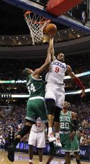 Philadelphia 76ers small forward Andre Iguodala dunks on Boston Celtics small forward Paul Pierce in Game 6