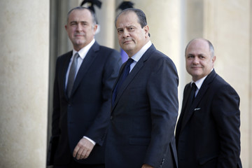 French Socialist party leaders arrive at the Elysee Palace in Paris