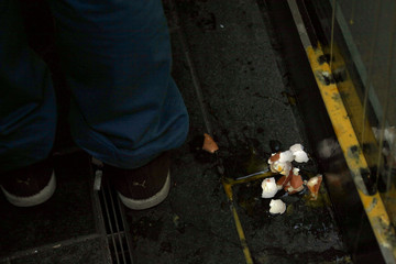 Eggs shells are seen at the bottom of a window after they were thrown at an Apple store in the Beijing