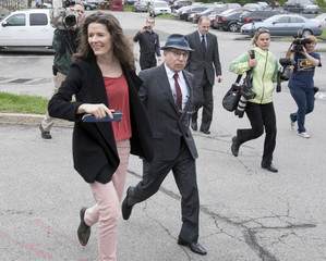 Singers Paul Simon and his wife Edie Brickell leave the Norwalk Superior Court in Norwalk, Connecticut