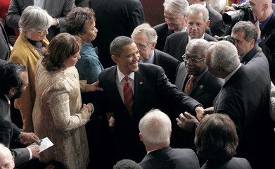 U.S. President Obama is congratulated by members of Congress after the conclusion of his first State of the Union Address on Capitol Hill in Washington