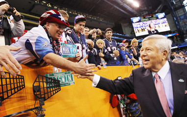 Patriots owner Kraft greets fans before his team plays the Giants in the NFL Super Bowl XLVI football game in Indianapolis