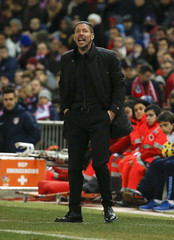 Atletico Madrid's coach Diego Simeone shouts during their Spanish First Division soccer match against Almeria at Vicente Calderon stadium in Madrid