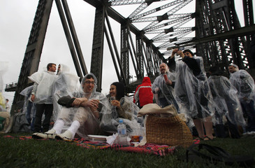 People picnic and take breakfast on the main deck of the Sydney Harbour Bridge during the Breakfast on the Bridge event in central Sydney