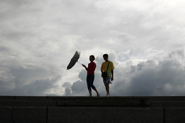 A beach-goer's umbrella is blown by the summer wind at Chishingtan Beach in Hualien County