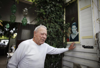 Van Wie who is partially blind stands outside his trailer in which he has lived for 20 years in Village Trailer Park in Santa Monica