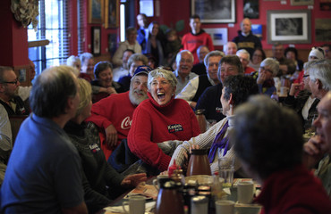 Supporters laugh during a town hall meeting with U.S. Republican presidential candidate and Ohio Governor John Kasich at Applewood House of Pancakes in Pawleys Island
