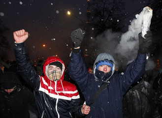 """Activists march during a rally called """"Patriotism is not fascism!"""" in Moscow"""