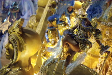 A reveller from the Uniao da Ilha samba school takes part in the parade on the second night of the annual Carnival parade in Rio de Janeiro's Sambadrome