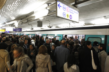 Passengers crowd into a metro at Saint-Lazare metro station in Paris