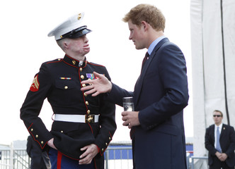Britain's Prince Harry speaks with a US Marine veteran on the deck of the USS Intrepid during his visit to New York
