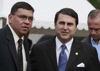 Paraguay's President Franco and anti-narcotics Minister de Vargas pose for a picture at the anti-narcotics department