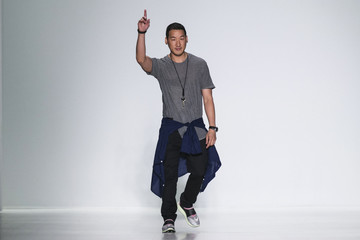 Designer Richard Chai greets attendees during his Spring/Summer 2015 collection at the New York Fashion Week
