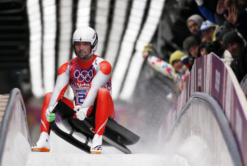 Poland's Maciej Kurowski comes to a stop after a run in the men's singles luge competition at the 2014 Sochi Winter Olympics
