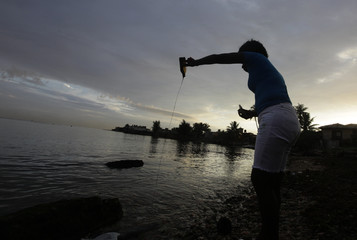 Cuban spiritualist, fortune teller and witch Mayra performs a Santeria ritual on a beach in Havana