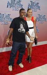 """Tracy Morgan and Sabina Morgan pose as they arrive for the premiere of the film """"The Last Airbender"""" in New York"""
