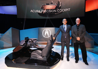 Jon Ikeda, VP and General Manager for Acura and Executive Creative Director Dave Marek pose for a photo as Acura introduces its Acura Precision cockpit design at the 2016 Los Angeles Auto Show in Los Angeles