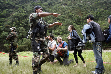 Peruvian police help to evacuate tourists by helicopter in Machu Picchu town in Cuzco