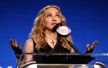 Recording artist Madonna reacts to a question during a news conference for her upcoming Super Bowl XLVI NFL football game halftime show in Indianapolis