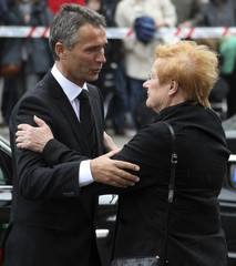 Finnish President Halonen comforts Norway's Prime Minister Stoltenberg at Oslo Cathedral in Oslo