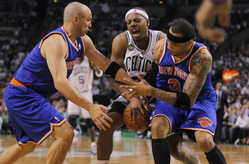 Boston Celtics Pierce competes for the ball with New York Knicks Kidd and Martin during second half Game 4 NBA Eastern Conference semifinal playoff basketball series in Boston