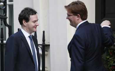 Britain's Chancellor of the Exchequer George Osborne and Chief Secretary to the Treasury Danny Alexander leave Downing Street in London