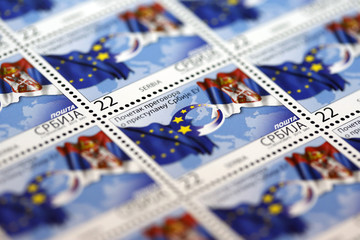 Special edition postage stamps depicting Serbian and EU flags are pictured in Belgrade