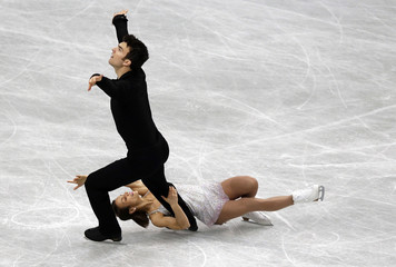 Canada's Duhamel and Radford compete during the pairs short program at the ISU World Figure Skating Championships in Saitama