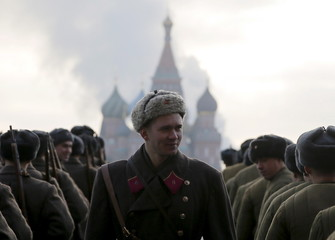 Russian servicemen dressed in historical uniforms take part in a military parade on the Red Square with St. Basil's Cathedral seen in the background in central Moscow