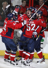 Washington Capitals' Alex Ovechkin (2nd L) celebrates his second period goal against the Boston Bruins with teammates Roman Hamrlik, Mike Green and Brooks Laich