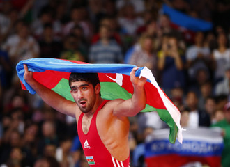 Azerbaijan's Toghrul Asgarov celebrates after defeating Russia's Besik Kudukhov on the final of the Men's 60Kg Freestyle wrestling at the ExCel venue during the London 2012 Olympic Games