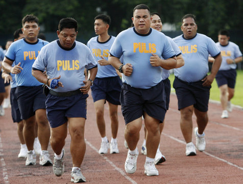 Police run during their Weight Loss Management Program at Camp Crame in Quezon City Metro Manila