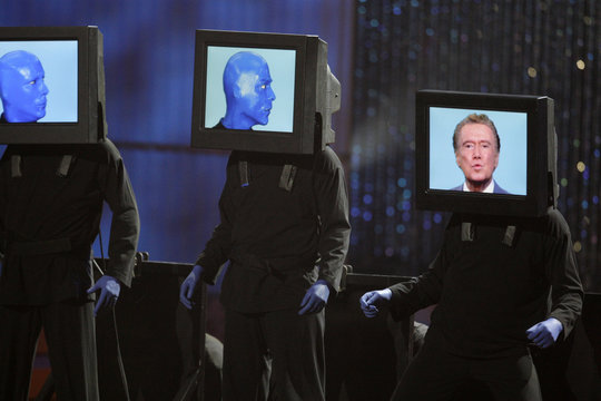 Members of the Blue Man Group introduce television host Regis Philbin, pictured on the screen at right, during the 37th Annual Daytime Emmy Awards show at the Las Vegas Hilton in Las Vegas