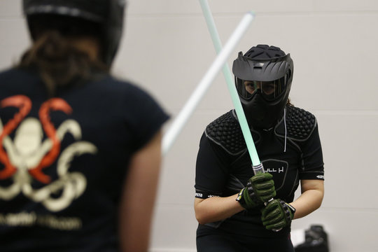 Competitors participate in a light saber duel tournament organized by the Sport Saber League in Paris, France