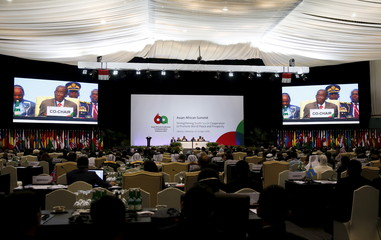 Zimbabwe President Robert Mugabe is seen on large screens as he speaks during closing remarks with Indonesian President Widodo at Asian-African Conference in Jakarta