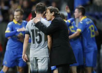 AS Roma's coach Garcia speaks with Pjanic as BATE Borisov's players celebrate scoring goal during their Champions League group E soccer match at Borisov Arena outside Minsk