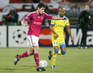 Olympique Lyon's Gourcuff challenges Boaventura of Apoel Nicosie during their Champions League soccer match at the Gerland stadium