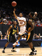 Southern California guard Jones shoots over Virginia Commonwealth University defenders Burgess and Skeen during their first round NCAA tournament basketball game in Dayton