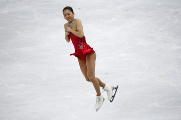 Akiko Suzuki competes during the figure skating women's short program at the 2014 Sochi Winter Olympics