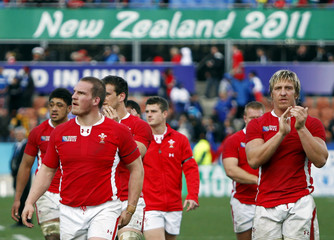 Wales players leave the field after beating Samoa in their Rugby World Cup Pool D match at Waikato Stadium in Hamilton