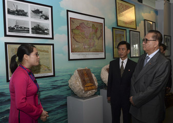 North Korea's Foreign Minister Ri looks at old maps, depicting the Paracel and Spratly archipelagos in the South China Sea, during his visit to the Hanoi Museum in Hanoi
