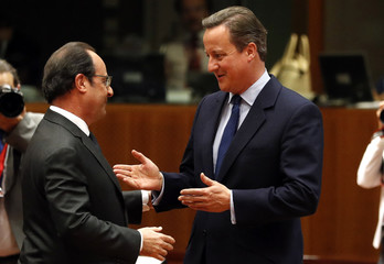 French President Hollande talks with Britain's PM Cameron during the EU Summit in Brussels