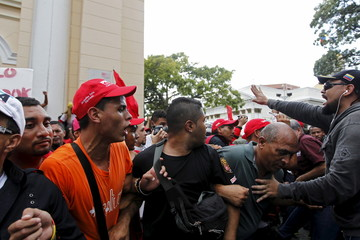 Supporters of Venezuela's President Maduro try to organise before the exit of the official deputies from the building housing the National Assembly in Caracas