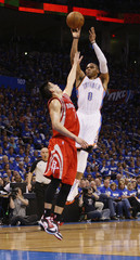 Oklahoma City Thunder guard Westbrook shoots against Houston Rockets guard Lin during the first half of their Game 1 NBA Playoffs basketball game in Oklahoma City